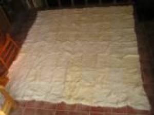 vendo alfombra de pelo de conejo blanco. est� en perfecto estado $1500